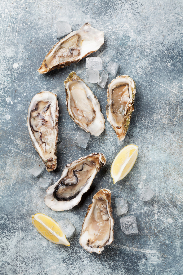 Fresh oysters on stone table - Stock Photo - Images