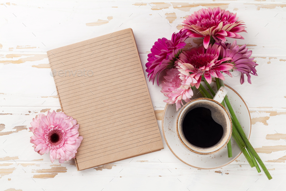 Coffee cup and gerbera flowers - Stock Photo - Images