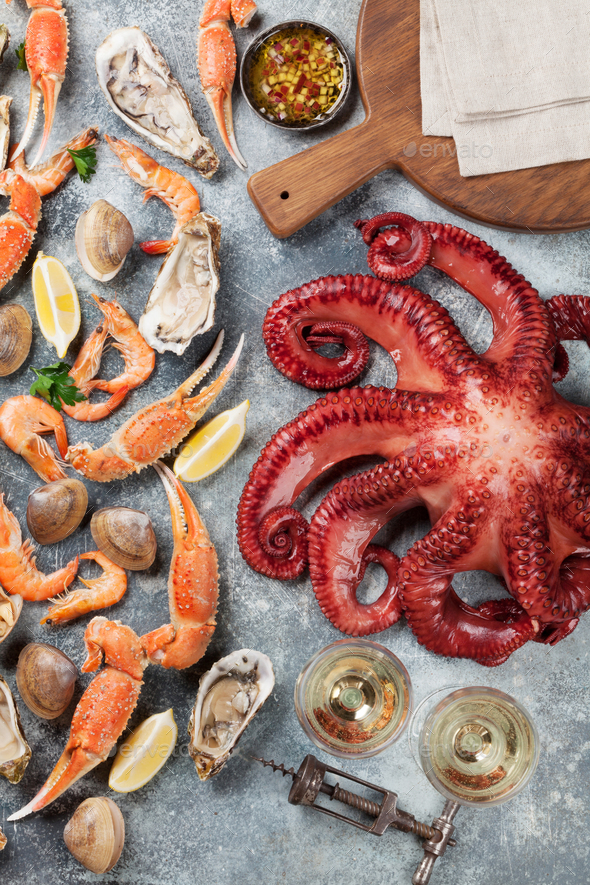 Seafood and wine. Octopus, lobster, shrimps - Stock Photo - Images