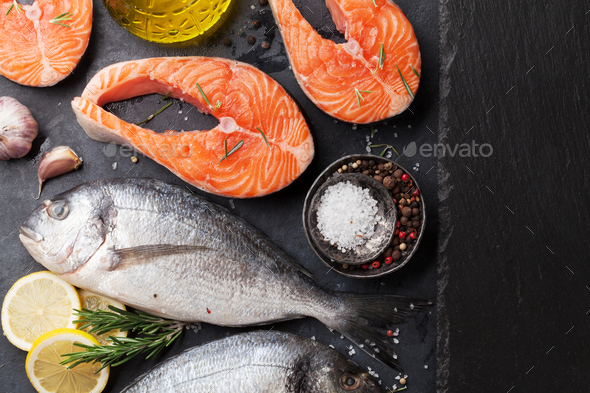 Raw salmon and dorado fish fillet - Stock Photo - Images