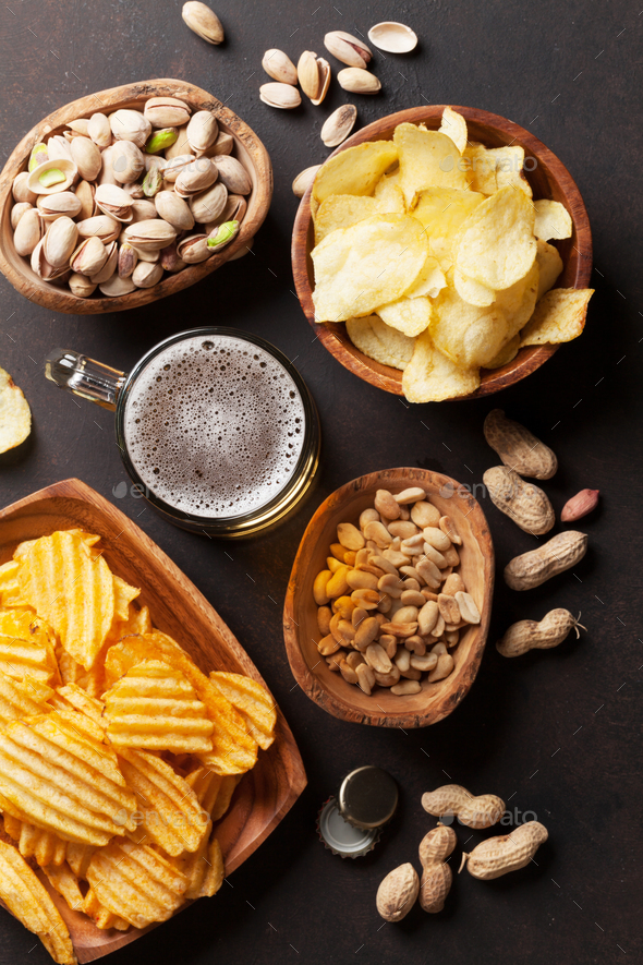 Lager beer and snacks on stone table - Stock Photo - Images