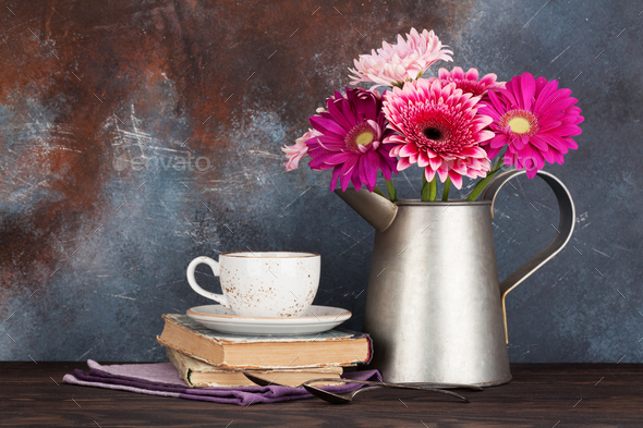 Gerbera flowers bouquet and coffee cup - Stock Photo - Images