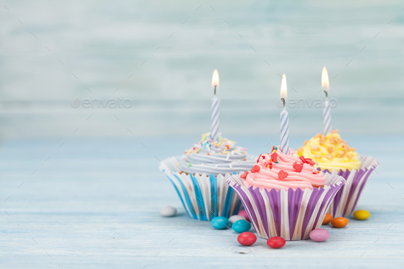 Sweet cupcakes with candles - Stock Photo - Images