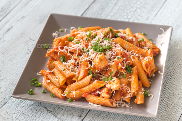 Portion of cheesy chicken pasta - Stock Photo - Images