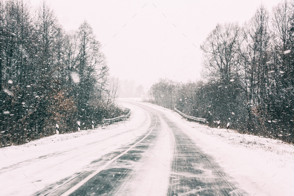 Snow-covered Open Road During A Winter Snowstorm. Adverse Weathe - Stock Photo - Images