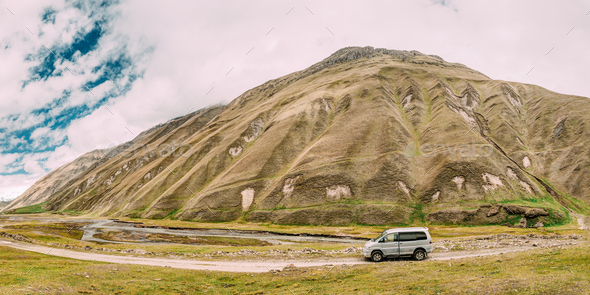 SUV Car On Off Road In Spring Mountains Landscape In Truso Gorge - Stock Photo - Images