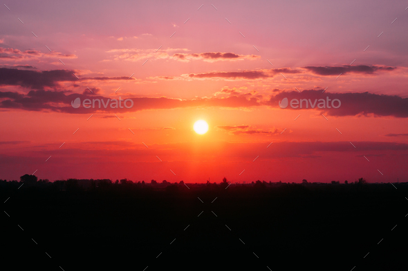 Sun Shining Over Dark Ground During Sunrise. Sunset Sky Landscap - Stock Photo - Images