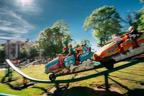 People Having Fun On Rollercoaster In Park. Photo With Zoom Blur - Stock Photo - Images