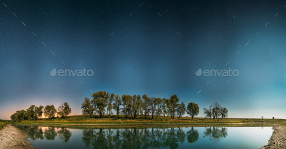 Night Starry Sky Above Lake River. Night Glowing Stars And Trees - Stock Photo - Images