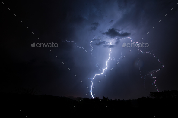 Cloud to ground lightning strike in night skies - Stock Photo - Images