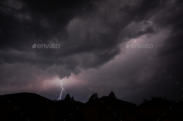 Lightning strike in cloudy skies - Stock Photo - Images