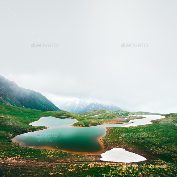 Koruldi lake Caucasus mountains on summer time - Stock Photo - Images