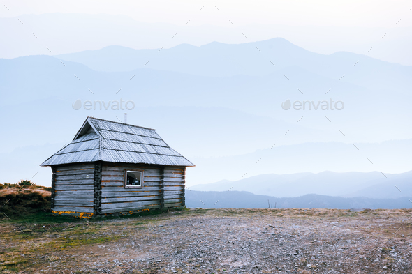 Mountain cabin during sunrise. - Stock Photo - Images