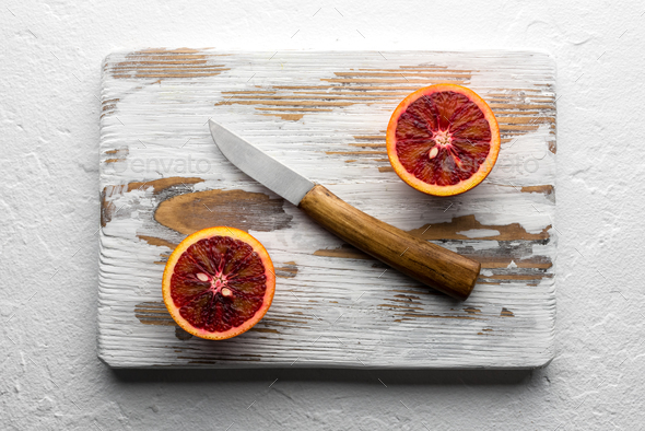 Orange pieces on wooden board closeup - Stock Photo - Images