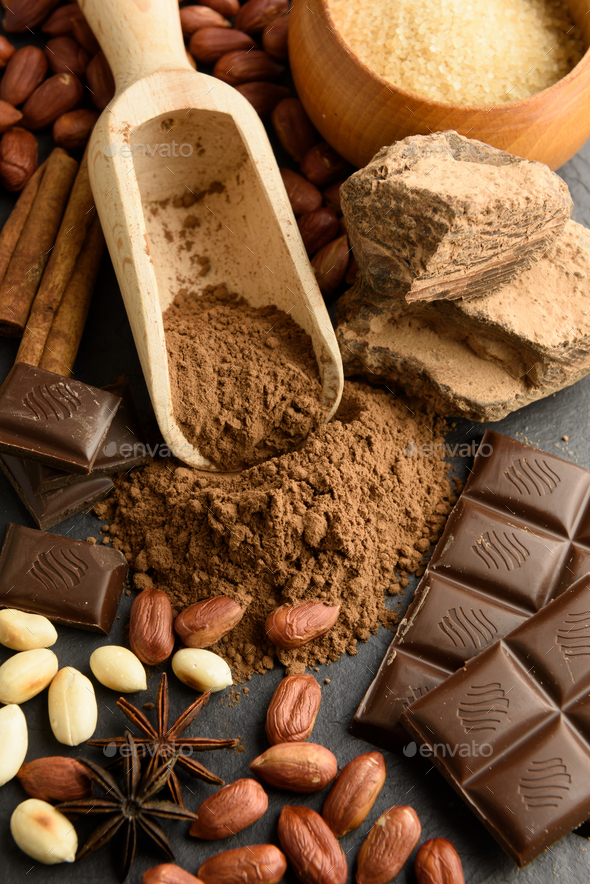 Cocoa powder, chocolate, nuts and spices - Stock Photo - Images