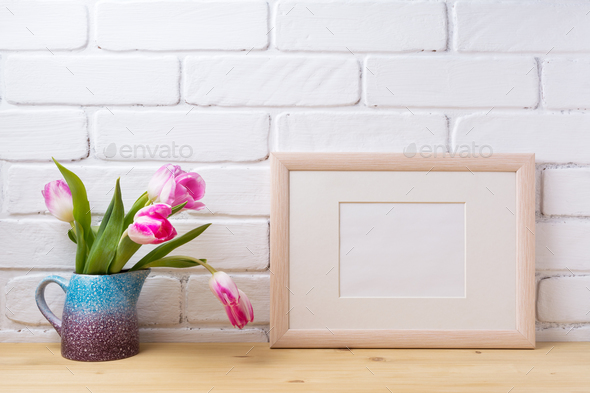 Wooden landscape frame mockup with pink tulip in purple pitcher - Stock Photo - Images