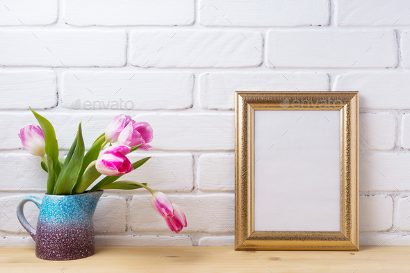 Gold decorated frame mockup with magenta pink tulips - Stock Photo - Images