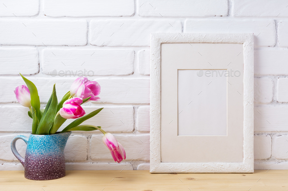 White frame mockup with pink tulip in blue pitcher - Stock Photo - Images