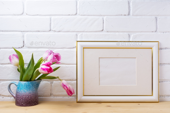 Gold decorated landscape frame mockup with magenta tulips - Stock Photo - Images