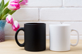 Black coffee mug and white cappuccino cup mockup with pink tulip - PhotoDune Item for Sale