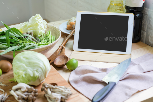 Ingredient and equipment for cooking with tablet - Stock Photo - Images