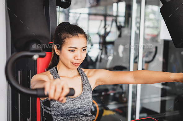 Young asian women with exercise-machine in sport gym - Stock Photo - Images