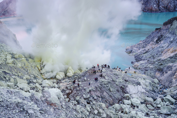 Sulfur burned in the crater blue lake at Kawah Ijen - Stock Photo - Images