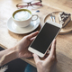 Young woman using smart phone in coffee shop - PhotoDune Item for Sale
