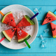 Watermelon slice popsicles with colorful stick on wooden background, Summer fruits - PhotoDune Item for Sale