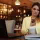 Beautiful Business Woman Fills Working Papers in Business Clothes - VideoHive Item for Sale