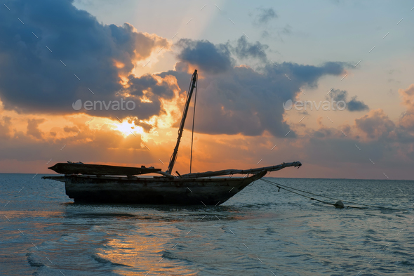Beautiful tropical sunset with boat - Stock Photo - Images