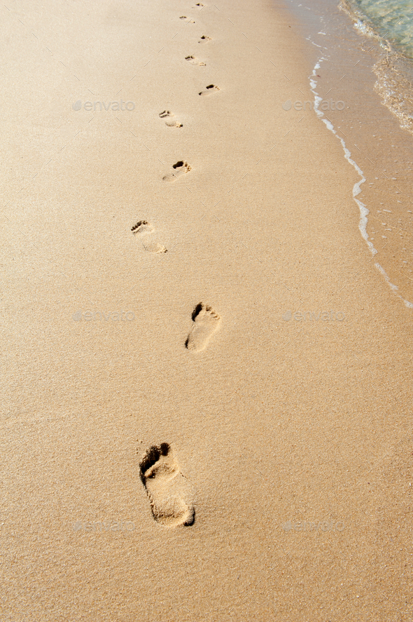 Footprints in the sand - Stock Photo - Images