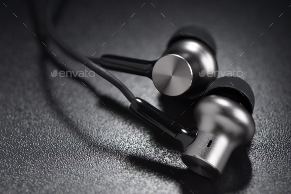 Metallic ear buds - Stock Photo - Images