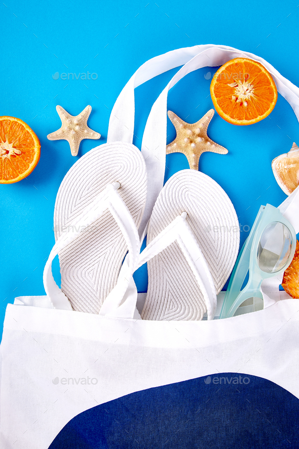 Summer beach bag with flip flops, - Stock Photo - Images