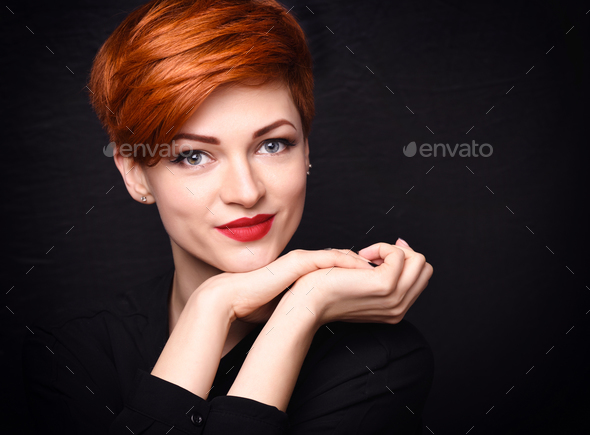 Portrait of a beautiful young red-haired woman with short hair o - Stock Photo - Images