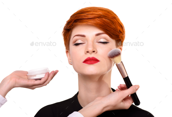 Make-up artist working with brush on model face. Beautiful young - Stock Photo - Images