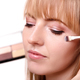 Process of making makeup. Make-up artist working with brush on m - PhotoDune Item for Sale