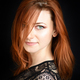 Portrait of a beautiful young woman with long red hair on a dark - PhotoDune Item for Sale
