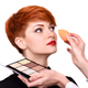 Makeup artist applying foundation on young woman's face using sp - PhotoDune Item for Sale