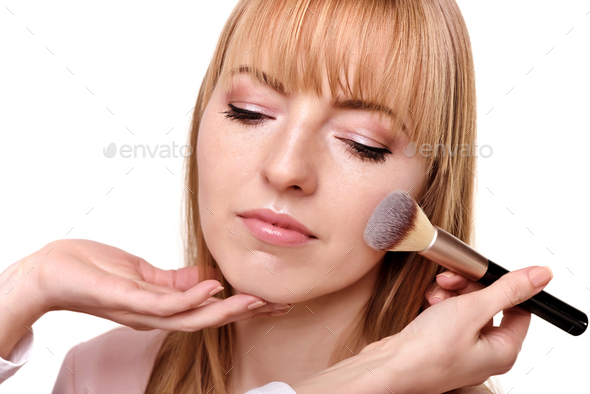 Process of making makeup. Make-up artist working with brush on m - Stock Photo - Images