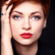 Portrait of a beautiful young red-haired woman with short hair o - PhotoDune Item for Sale