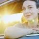 Attractive Woman Looks Out the Car Window, Portrait. Behind Her Are the Rays of the Setting Sun - VideoHive Item for Sale