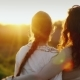 Mom and Daughter 11 Years Embrace, Look Together at a Beautiful Sunset. Good Relations in the Family - VideoHive Item for Sale