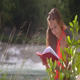 Sun Lights Girl Long Hair Reads Book on Windy Day - VideoHive Item for Sale