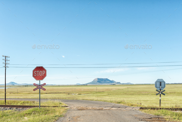 Level railway road crossing at Tweespruit in the Free State - Stock Photo - Images