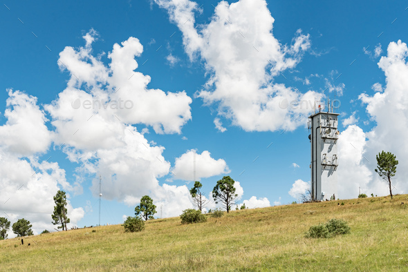 Microwave telecommunications tower on a mountain at Ficksburg - Stock Photo - Images