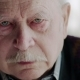 Grief-stricken Old Man with Red Rimmed Eyes Looking at the Camera - VideoHive Item for Sale
