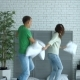 Happy Couple Having Pillow Fight in the Bedroom - VideoHive Item for Sale