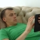 Joyful Man Websurfing with Tablet Pc on the Couch - VideoHive Item for Sale