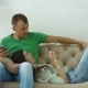 Happy Couple with Smart Phones Relaxing at Home - VideoHive Item for Sale